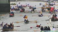 Rowing boats begin pageant on Thames