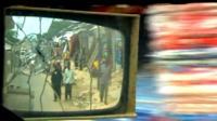 View in vehicle's wing mirror of Mogadishu street