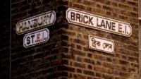 A street sign for Brick Lane