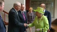 Sinn Fein first minister Martin McGuinness shakes hands with The Queen