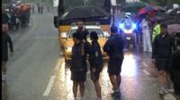 Olympic torch staff halt the relay due to lightening