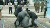 Security agents arrest the South Korean activist