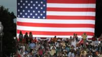 American people stand by giant US flag