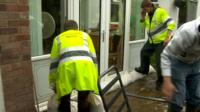 Environment agency workers sand bagging