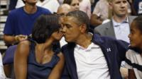 Barack Obama kisses wife, Michelle