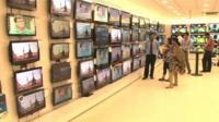 Televisions for sale in one of India's electronics retailers