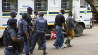 Police escort mineworkers on August 27