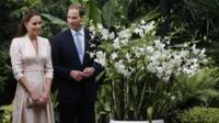 The Duke and Duchess of Cambridge look at an orchid named after Prince William's mother Diana, Princess of Wales during their first engagement in Singapore
