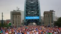 Runners cross the Tyne Bridge during the Great North Run