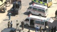 Ambulances around the site of a suicide attack in Mogadishu