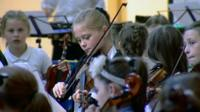 Children in an orchestra