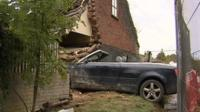 Car crashed into side of house