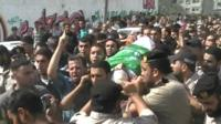 Mourners in the Gaza Strip bury a Palestinian militant
