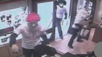 CCTV showing armed raiders inside a jewellery shop in Wigan