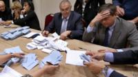 UMP party members count ballots in Nice, southeastern France, 18 November 2012