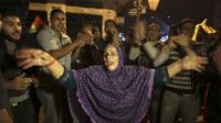 Palestinians celebrate the ceasefire, which they say is a victory over Israel
