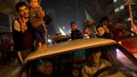 Palestinians celebrate the Israel-Hamas cease-fire in Gaza City, Wednesday, Nov. 21, 2012