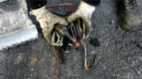 Hands grasp copper wire