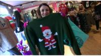 Woman holding Christmas jumper