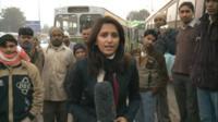 The BBC's Yogita Limaye at a bus stop