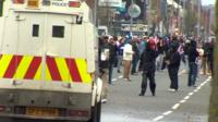 Protesters face police vehicle in Belfast