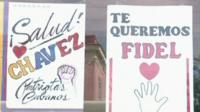 Posters saying 'Salud Chavez' and 'Te Queremos Fidel'