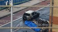 Debris and a burned out car are pictured at the scene of a helicopter crash in Vauxhall
