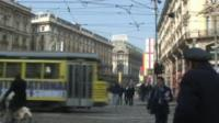 Street in Italy with tram