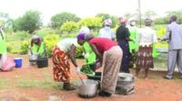 Farmers in Zambia drying and preparing vegetables