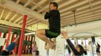 The BBC's Mike Bushell tries pole fitness