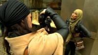 Artist Sara Shamsavari photographs a woman wearing a hijab