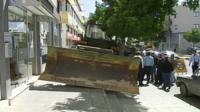 Bulldozer outside bank