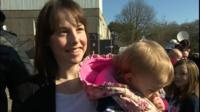 A mother in a queue for MMR jabs in Swansea