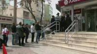 People queuing for a cash point in Cyprus