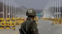 A South Korean soldier stands at a military check point connecting South and North Korea