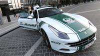 Dubai policewoman and Ferrari patrol car