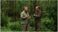 Roger Harrabin talking to an environmentalist in a forest