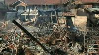 Wreckage of burned out building in Burma