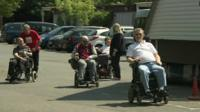 People in wheelchairs