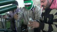 Syrian opposition fighters with homemade weapons