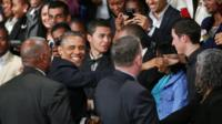U.S. President Barack Obama greets the public as he arrives to deliver remarks and takes questions at a town hall meeting with young African leaders at the University of Johannesburg Soweto campus Saturday June 29