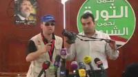 Members of the Muslim Brotherhood hold up a camera