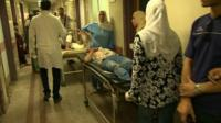 Hospital corridor in Cairo with patients on trolleys