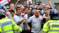 EDL members clash with the police during a EDL march at Centenary Square in Birmingham