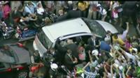 Crowds surround the pontiff's car on its way from the airport