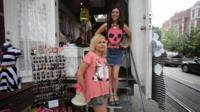 Two women outside of a fashion truck