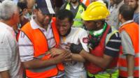 Man comforted on Cairo streets