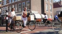 Women at Dutch bicycle traffic lights