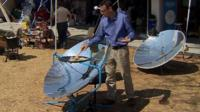 Will Ross with solar cooker