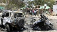 Destroyed vehicles at the scene near the Village restaurant in Mogadishu